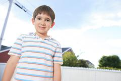 Closeup of cute young teen boy smiling Stock Photos