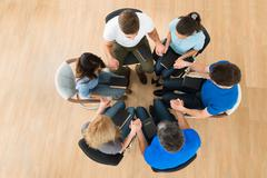 High Angle View Of People Holding Each Others Hand Praying Together Stock Photos