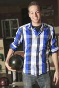 A bowling player in the alley - stock photo