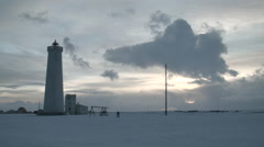 Lighthouse and Winter Sunset - Time lapse - stock footage