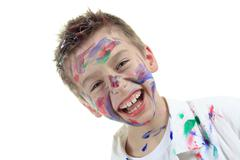 Little boy with painting face over white background Stock Photos