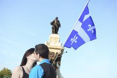 A couple shooting on the city of Quebec - stock photo
