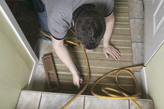 A ventilation cleaner man at work with tool Stock Photos