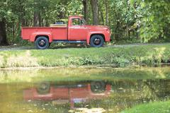 A old retro beautiful red truck  in a park Stock Photos