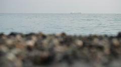 Alone cargo ship in the sea horizon - stock footage