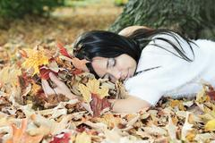 A beautiful autumn woman having good time - stock photo