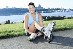 A woman with is rollerblade in summer time Stock Photos