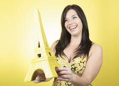Eiffel tour woman yellow - stock photo