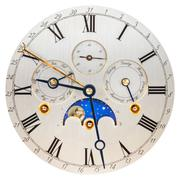 Antique silver clock face with moon rotation - stock photo