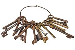 Set of vintage rusty keys on a ring isolated on white - stock photo
