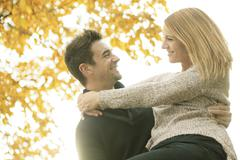 A Young happy couple in autumn season - stock photo
