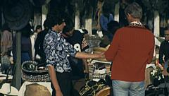 Mexico city 1975: man selling hand made products at the market Stock Footage