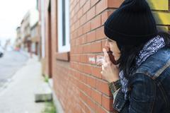 Suspicious Woman watch - stock photo