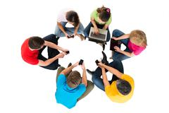 Group Of People Using Electronic Devices For Social Network - stock photo