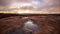 Stock Video Footage of Time-lapse at sunset in Arches National Park reflecting out of a pool of water.