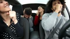 Cool friends singing like crazy in car annoying man Stock Footage