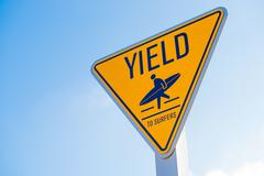 Yield to surfer sign in Southern California Stock Photos