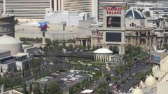 Aerial view Caesar Palace resort Las Vegas Strip traffic avenue people travel US Stock Footage
