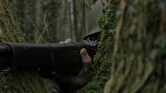 WW2 American infantry  soldier takes aim from behinde tree Stock Footage
