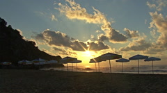 Summer Beach coast with umbrellas at Sunset, Sunrise. Stock Footage