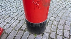 Tilt shot of an Iconic Red Post Box in London United Kingdom Stock Footage