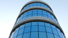 ESTABLISHING SHOT. CIRCULAR TOWER OF OFFICE BUILDING.  EXTERIOR / DAY. Stock Footage