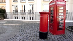 A pan of an Iconic Red Post Box and Red  Phone Box, London United kingdom Stock Footage