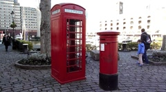Wide angle of a London Iconic Red Post Box and Red  Phone Box London UK  Stock Footage
