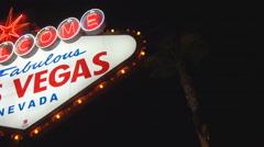 Pan left Las Vegas Welcome Sign night illuminated stars signboard landmark icon  Stock Footage