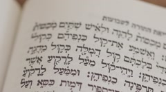 Hebrew text pan across bible Stock Footage