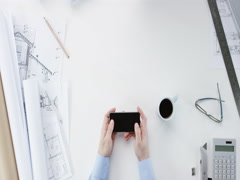 Top view Architect designing connected home using smartphone touchscreen hands - stock footage