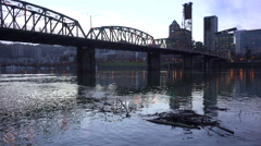 A wide shot across the Willamette River to Portland, Oregon at dusk with Stock Footage