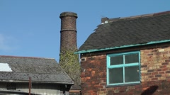 Industrial architecture conical bottle kiln blue window sky Stock Footage