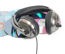headphone in CD stack - stock photo