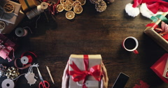 Top view woman holding christmas present  at desk hands from above - Red Epic Stock Footage
