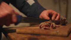 Hands cutting homemade salami sausages Stock Footage