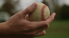 Pitcher Shifts Baseball Around in Hand Stock Footage