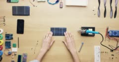 Top view femal technician soldering solar panels green energy concept from above Stock Footage