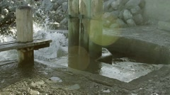 Water crashing into rocks - stock footage