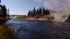 Hot water flowing rapidly in Firehole River near Grand Prismatic Spring Stock Footage