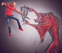 Man versus evil Stock Photos
