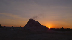 View of small geyser at sunset near Firehole Drive Stock Footage