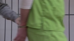 Guard Removes Inmates Handcuffs (5 of 9) Stock Footage