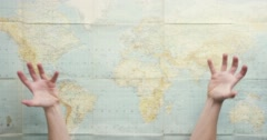 Top view hands showing global domination market monopoly vintage world map from - stock footage