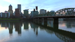 A wide shot across the Willamette River to Portland, Oregon at dusk. Stock Footage