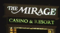 The Mirage sign Las Vegas tourism attraction travel destination landmark night Stock Footage