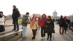 People walking on the Pont Des Arts Bridge, Paris, France. Stock Footage