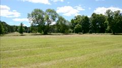 Hay roll in field summer 04Pansvv Stock Footage