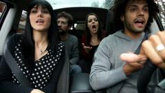 Four friends fighting and laughing in car Stock Footage