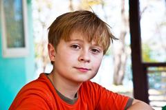 Boy with brown eyes is looking self confident and happy Stock Photos